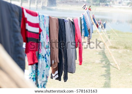 Drying clothes on sun outside after washing it in the Narayani River at Narayangadh,Nepal. #578163163