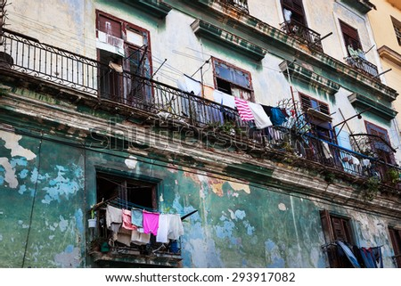 drying clothes on the balcony of the old building