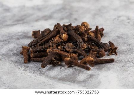 Drying clove spice (Syzygium aromaticum) Cloves are the aromatic flower buds of a tree #753322738