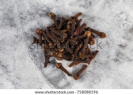 Drying clove spice (Syzygium aromaticum) Cloves are the aromatic flower buds of a tree #758088196