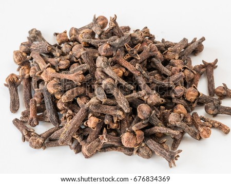 Drying clove spice (Syzygium aromaticum) Cloves are the aromatic flower buds of a tree in the family Myrtaceae. #676834369