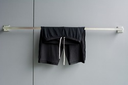 drying man swimming suit on wall background from swimming pool.