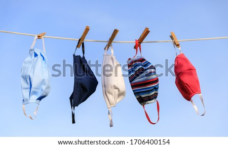 Drying mask hanging under the sun after use for disinfecting. Hygienic mask hanging on the rack outdoor after being washed for cleanness and hygiene during Covid-19 virus outbreak