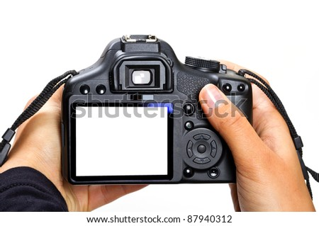 DSLR camera in female hands isolated on white - stock photo