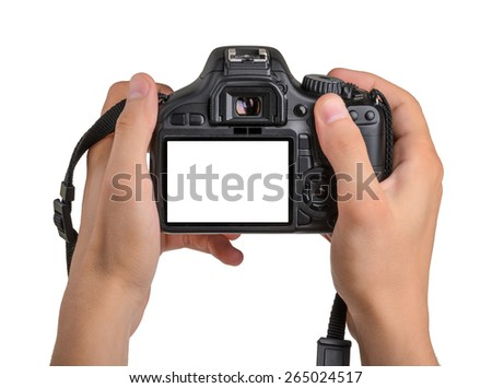 DSLR camera in hand isolated #265024517