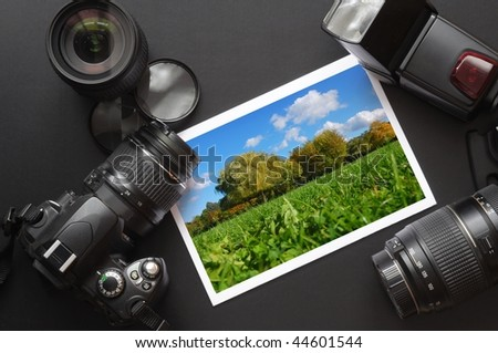 dslr camera lens and image on black background