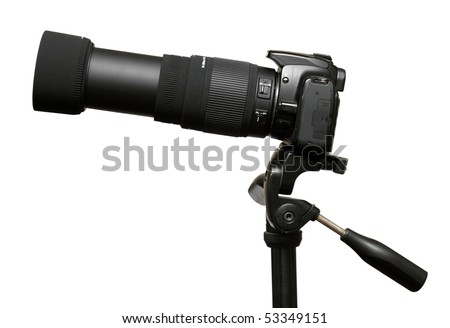 DSLR camera with telephoto zoom lens on tripod isolated on white
