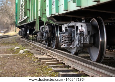 Dual gauge track example that allows the passage of trains of two different track gauges narrow-gauge railway and broad-gauge railway with freight wagons on it.