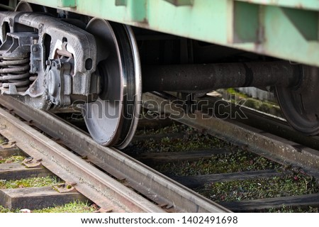 Dual gauge tracks example that allows the passage of trains of two different track gauges narrow-gauge railway and broad-gauge railway with freight wagon.