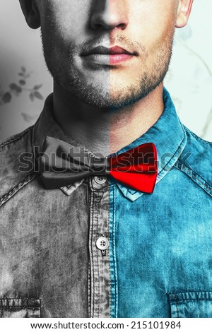 Dual male fashion portrait concept. Young and handsome hipster man in blue jeans shirt and red bow-tie over vintage background. Close up. Studio shot. Copy-space.