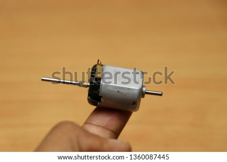 Dual Shaft dc motor which is modified from old toy dc motor so that work of two dc motor can be done by one motor #1360087445