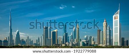Dubai - amazing city center skyline with luxury skyscrapers and beautiful sky at sunrise, United Arab Emirates