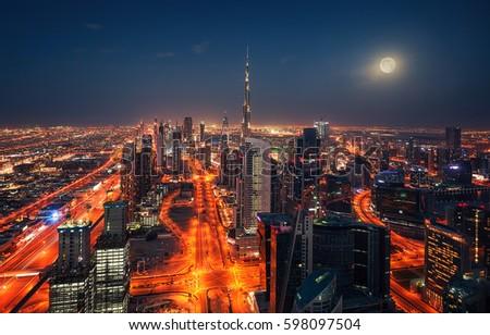 Dubai at night with full moon
