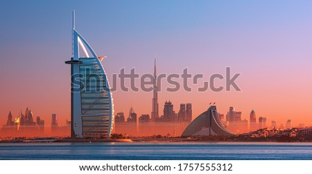Dubai city - amazing city center skyline and famous Jumeirah beach at sunset, United Arab Emirates