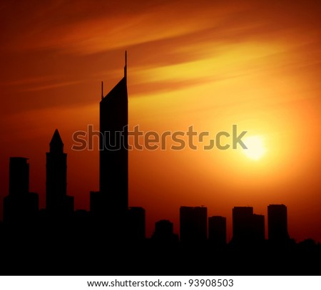 Dubai city at night Sheikh Zayed road at sunset, silhouette of modern new Middle Eastern city, black shape of buildings with natural sun light background, United Arab Emirates