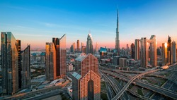 Dubai city center and Sheikh Zayed bussy intersection before  sunset with colorful sky, United Arab Emirates