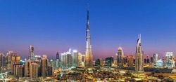 Dubai - city center skyline and bussy evening after sunset with colorful sky, United Arab Emirates