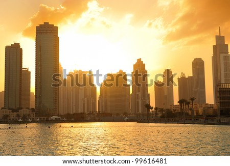 dubai city skyline at sunset conctruction and modern architecture concept