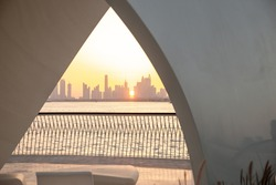 Dubai Creek Harbour at sunset with arch and water infront