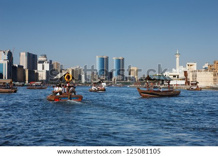 DUBAI CREEK, UAE - MAY 27 - Skyline view of Dubai Creek with traditional boat taxi activity. The creek is dividing the city into two main sections - Deira and Bur Dubai. Picture taken on May 27, 2010.