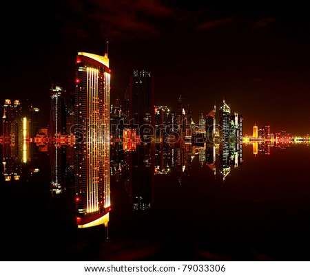 Dubai downtown at night with reflection in water, modern design of new city