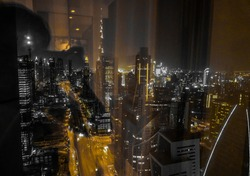 Dubai downtown behind a glass window, Glass window reflection, Out of focus glass window view