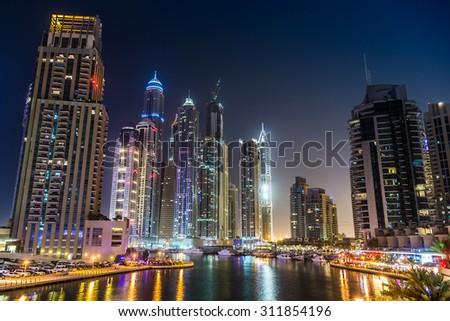Dubai downtown night scene. Modern skyscrapers in Dubai  in a summer night