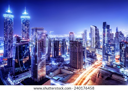 Dubai downtown night scene, UAE, beautiful modern buildings, bright glowing lights, luxurious travel and tourism