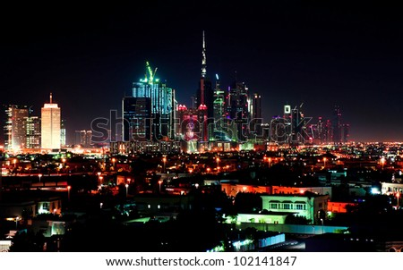 Dubai downtown night scene with city lights - stock photo