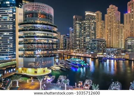 Dubai evening skyline. Dubai Marina skyscrapers, yachts. Iconic place. Dubai entertainment and leisure. Travel icon. Best city views. Pier 7 restaurants. JBR buildings. Yacht club.