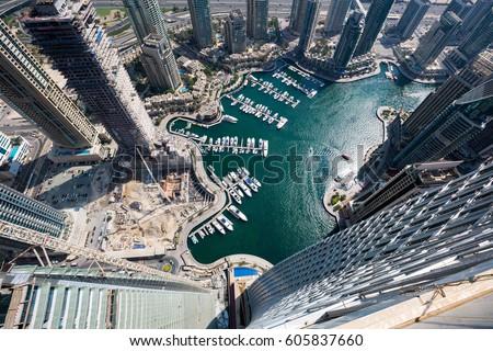 Dubai iconic view. Dubai Marina from above. Dubai construction. Futuristic city. Modern city from above. Modern architecture. Cayan tower Dubai Marina.