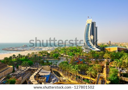 DUBAI-JUNE 20: View of Jumeirah Beach on June 20, 2012 in Dubai. Jumeirah Beach is a hotel in Dubai, United Arab Emirates which contains 598 rooms,waterpark,19 beachfront villas, and 20 restaurants. - stock photo