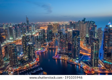 Dubai Marina at Blue hour, Glittering lights and tallest skyscrapers during a clear evening with Blue sky. #191035946