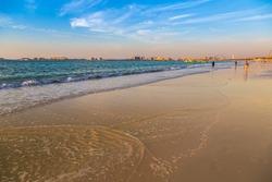 Dubai marina beach in the summer evening, sunset, UAE
