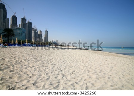 Dubai Marina complex under construction by beach - stock photo