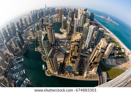 Dubai Marina skyline. Futuristic city. Dubai skyscrapers. Modern city view. Dubai from above. Cayan tower view.