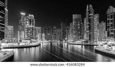 DUBAI MARINA,UNITED ARAB EMIRATES-MARCH 11, 2016: View on Dubai Marina with luxury boats, yachts and promenade,Dubai,United Arab Emirates #456083284