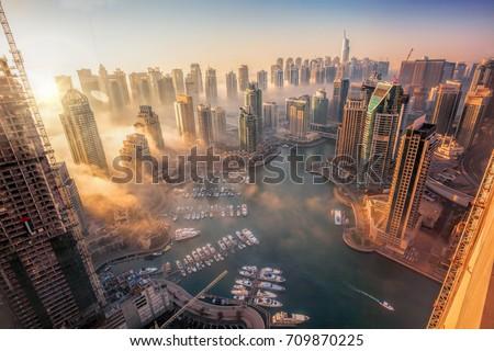 Dubai Marina with colorful sunset in Dubai, United Arab Emirates