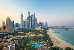 Dubai Marina with skyline - luxury and famous Jumeirah beach frontline at sunrise, United Arab Emirates