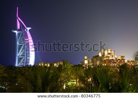 DUBAI - MAY 12: Burj al Arab hotel, one of the few 7 stars hotel in the world and one of the most recognized luxury symbol as seen from the Madinat Jumeirah Resort at night on May 12, 2011 in Dubai - stock photo