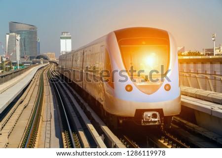 Dubai Metro Network line on the urban landscape UAE, architecture with subway monorail train automated.