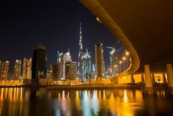 Dubai night skyline. Dubai  skyscraper construction. Dubai Downtown views. Dubai evening cityscape. Burj Khalifa tallest building in the world. Dubai futuristic city. City lights.