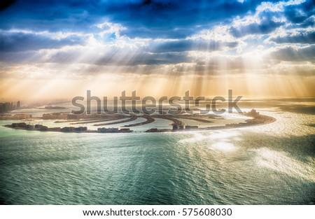 Dubai Palm Jumeirah Island with sun says. #575608030