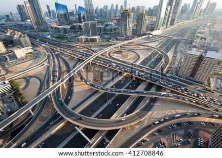 Dubai roads. Dubai crossroads. Dubai junction. Dubai intersection. Dubai car traffic. Dubai transport. Dubai highways. Dubai busy roads. Dubai Interchange 1. Dubai Sheikh Zayed road. Dubai traffic.