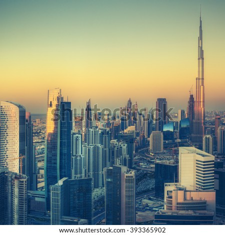 Dubai's business bay with famous skyscrapers. Beautiful cityscape at sunset. Vintage effect.