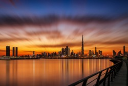 Dubai silhouette Skyline very Dramatic Clouds in Sunset Time with Water and reflection