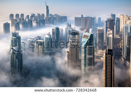 Dubai skyline, an impressive aerial top view of the city in Dubai Marina on a foggy day stock photo