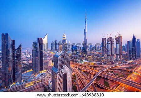 Dubai skyline at sunset with beautiful city center lights and Sheikh Zayed road traffic, Dubai, United Arab Emirates