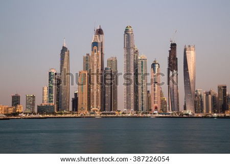 Dubai skyline. Dubai cityscape. Dubai Marina skyscrapers Cayan Tower, Princess Tower, Marina 101. Dubai evening skyline.Dubai Marina skyline.Dubai iconic view.Palm Jumeirah views. Dubai sunset colors.