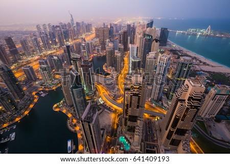 Dubai skyline, skyscrapers. Dubai Marina from above. Morning light. Dubai citylights. Luxury homes, private property. Cayan tower view.